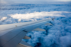 Jet Airliner wing and clouds